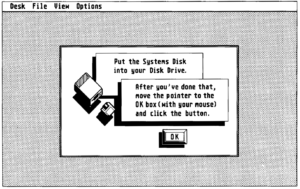 Image from manual of computer asking for TOS floppy disk
